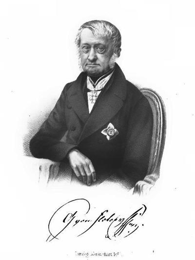 Historisches Portrait eines äkteren Mannes, an einem Tisch sitzend; wikimedia, gemeinfrei