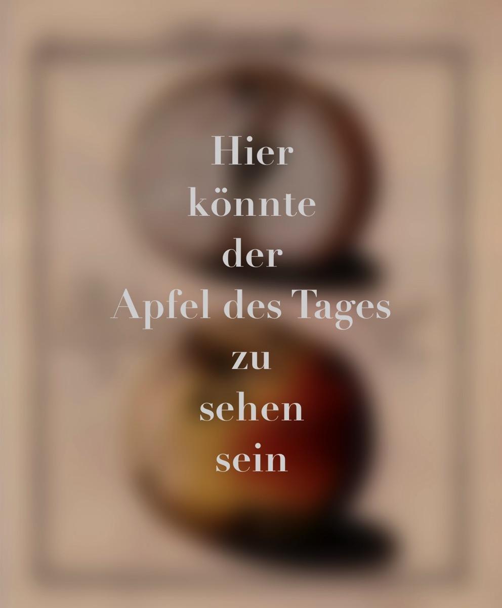 Auf einem verschwommenem Hintergrund der Text: Hier könnte der Apfel des Tages zu sehen sein