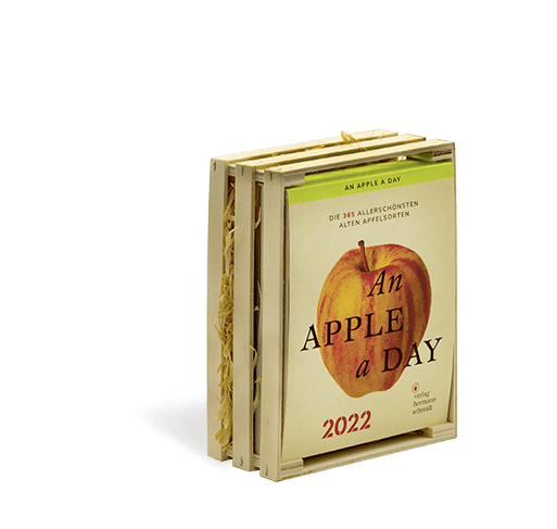 Ein Kalender in einer kleinen Holzkiste, auf dem Titelbild ein Apfel und der Titel An Apple a Day 2022